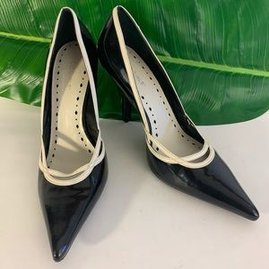 Black patent leather pumps.
